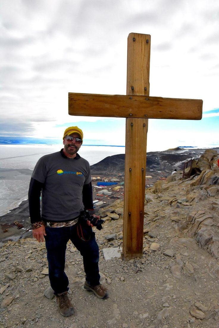"One of my greatest travel moments - standing on the summit of ""ObHill"" at McMurdo Station and the memorial cross to British Polar Explorer Robert Scott and his men of the doomed Terra Nova expedition and death race to the South Pole in 1912 #antarctica #theotherside @oceanwideexp"