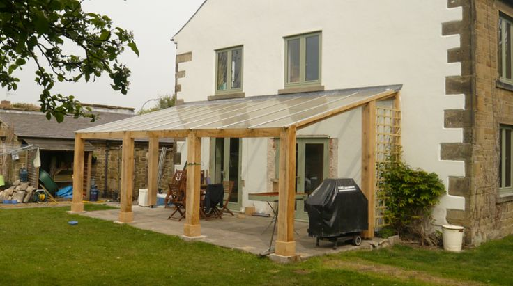 Year-Round Outdoor Space, covered back garden veranda. Maybe something like this would help for all the rainy days? More
