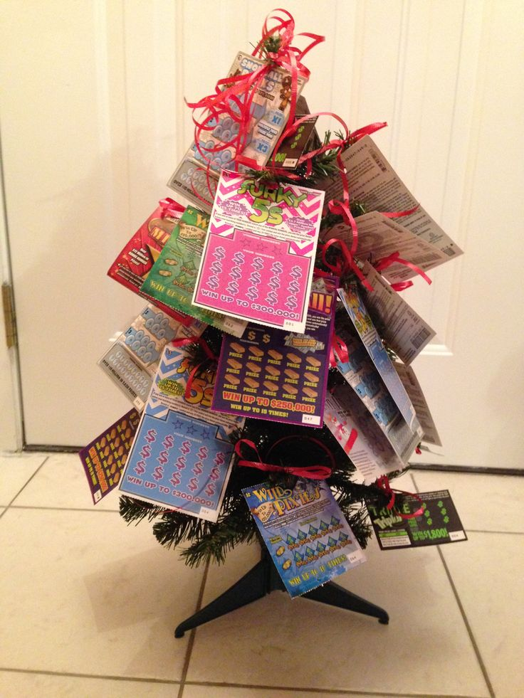 I made this Lottery Christmas Tree for a fundraiser.  Punched a hole in each ticket and strung red ribbon through each one and tied to the tree branches!  I will wrap it in cellophane and put a pretty Christmas bow on it!  I bought the 2 foot tree at Target for $7