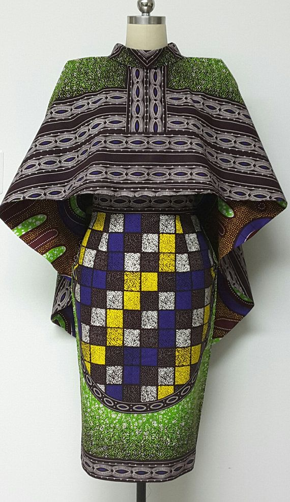 Il s'agit d'une jupe crayon polyvalent réversible African Print Hi-Lo Cape et entièrement doublé avec fente ouverte au dos. Vous pouvez coupler la Cape réversible avec des pantalons, jupes et robes. Il va sûrement améliorer votre garde-robe. Longueur de l