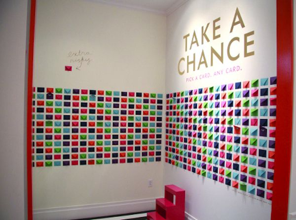 Small envelopes mounted to wall.   Great idea for charity wall or even craft booth with cents off coupons