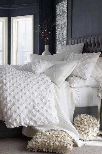 Add texture to an otherwise plain white bed with ruffled pillowcases and a puckered duvet.