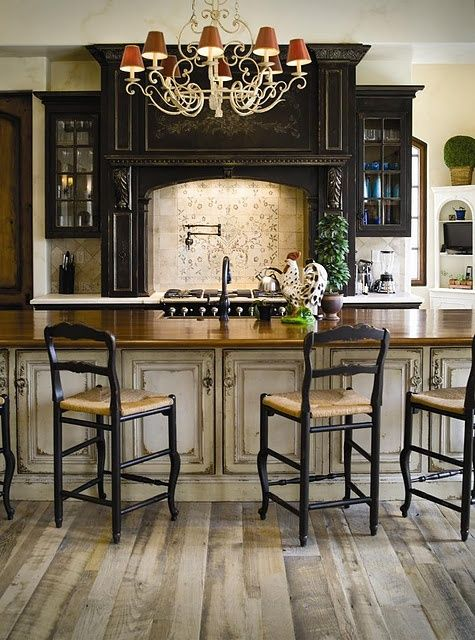 Love the distressed/antique finished cabinets! french country design                                                                                                                                                      More