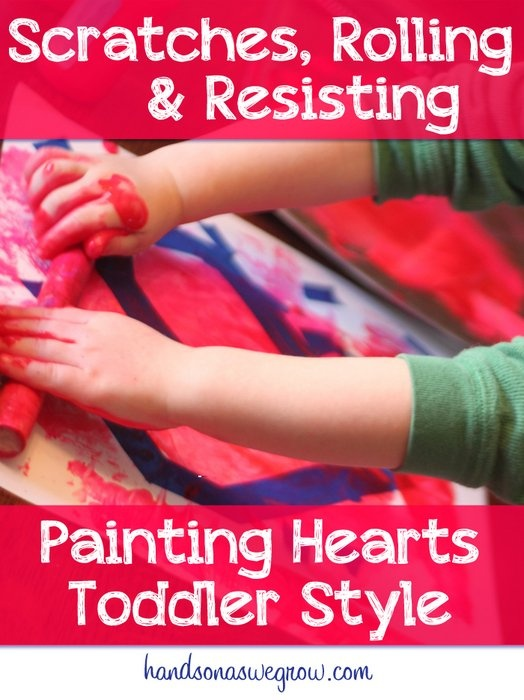 Making Valentine art, toddler style. Roll the paint on, scratch it up, remove the tape. Pretty hearts!