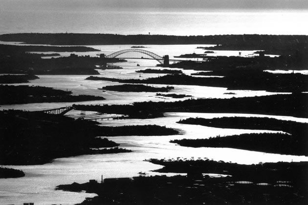 Sydney Harbour after sunrise looking east -1963.  Photograph by David Moore.