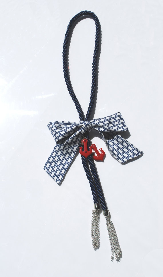 115 cm long textile rope necklace.  The metal chains and the resin anchors create navy-like accessories.  A large tie-like silk bow puts the finishing touches on the centre.    This object has been made with optimum quality entirely handmade materials and accessories. Each small imperfection makes the item unique. #jewels