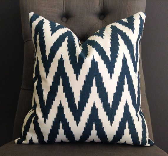 Bring style to your living space with this blue chevron pillow. The fabric is made by West Elm and it has a very sturdy feel to it and will