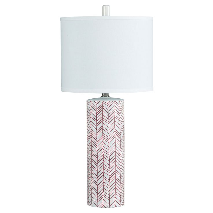 With its zigzag graphics, this lamp injects a sense of energy and vibrancy into your space. A tasteful palette of paprika on a white background is a chic study in contrasts.  Signature Design by Ashley is a registered trademark of Ashley Furniture Industries, Inc.