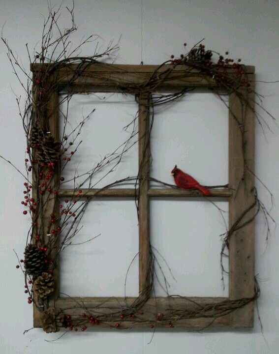 Window frame with grapevine wrapped around with cardinal ...