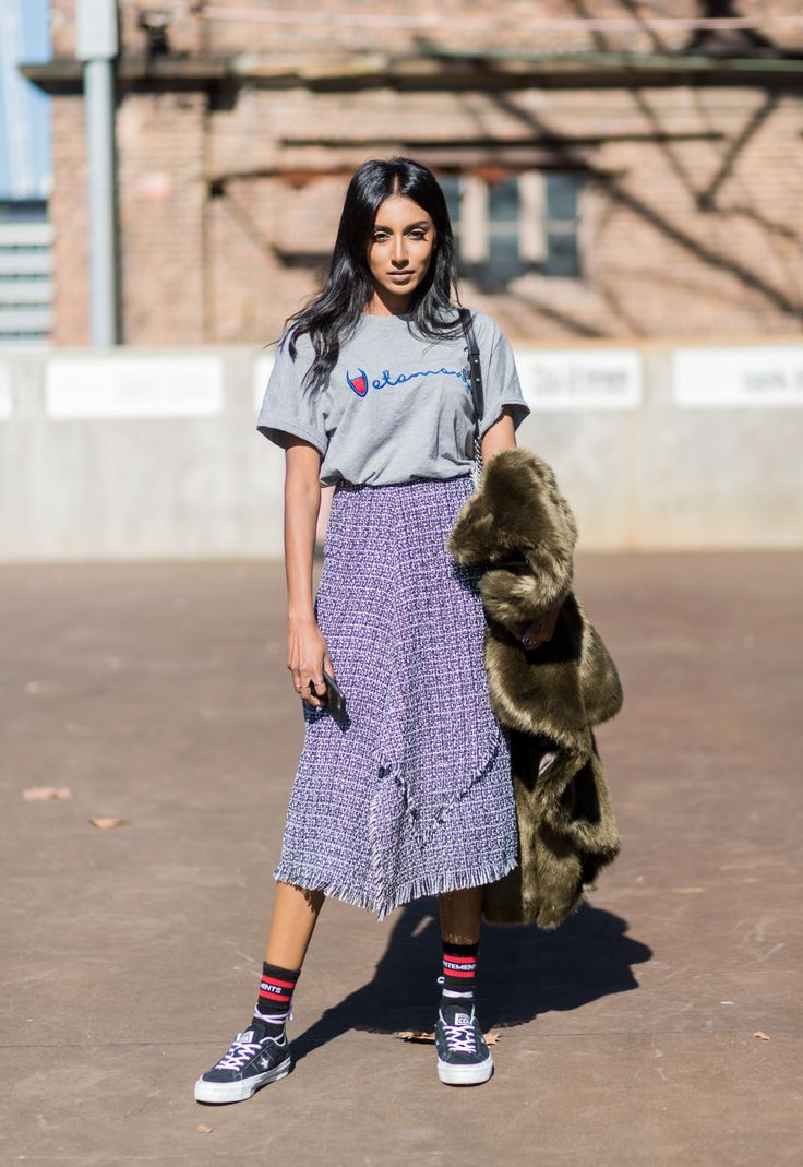 Toughen up tweed with sneakers and a casual t-shirt http://www.elle.com/fashion/shopping/g27780/new-ways-to-wear-midi-skirts/?slide=2