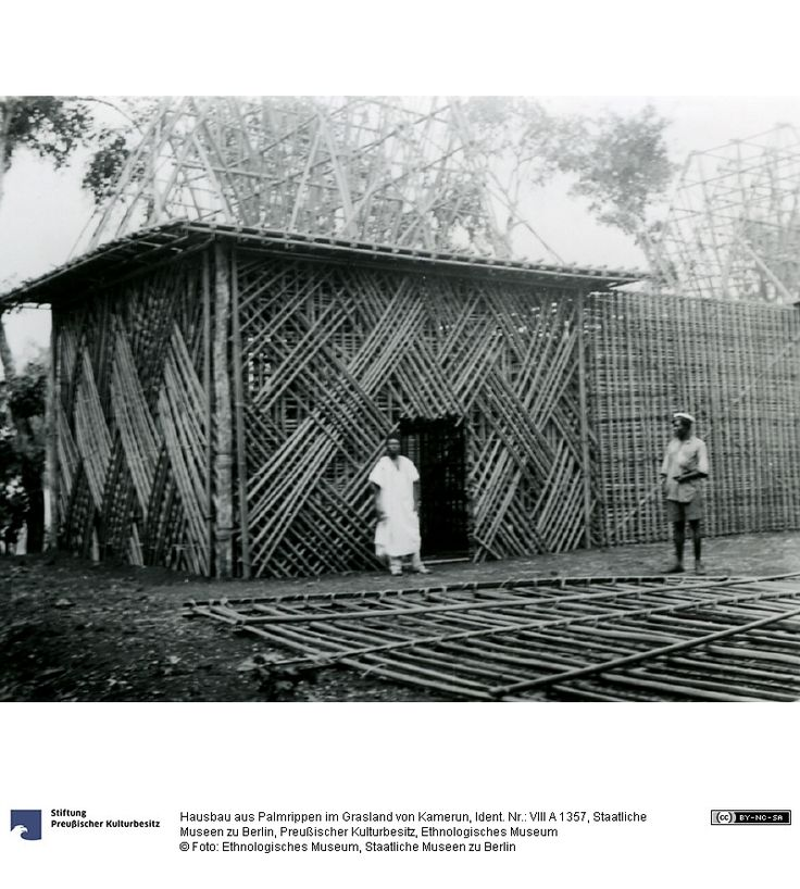 House being built of prefab sections, early 20th c #Cameroon #African architecture