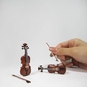 Miniature Violin Made Using Wooden Popsicle Sticks – Artist Cath of The Square to Spare has created a great video tutorial on how to make a miniature violin using wooden Popsicle sticks, coffee stirrers, toothpicks, and string. Getting started on a new project! I think...