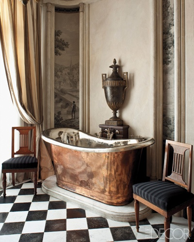 antique style copper bath tub accents the black and white check tile. Love this.