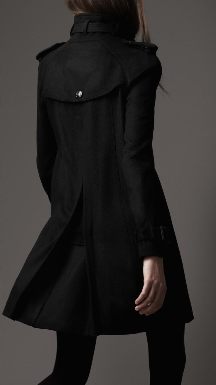 """This flares out very gracefully at the back. It has an elongated central back pleat. Very dramatic. """"Sherlock Chic""""!"""