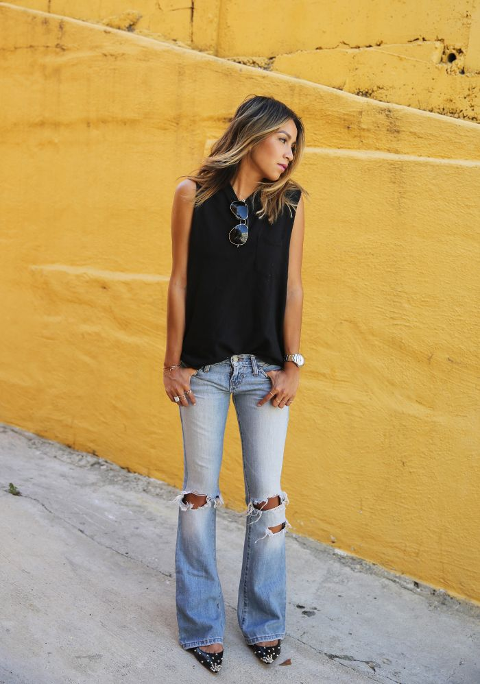 Flare Jeans Outfit Ideas - spring / summer - street chic style - aviators + black sleeveless sweatshirt + light denim distressed flare jeans + black studded pointed flats