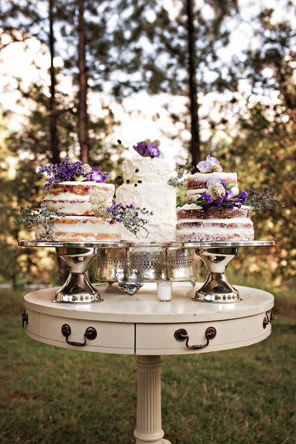 Purple flowers were a nice touch on these wedding cakes | Amila Photography