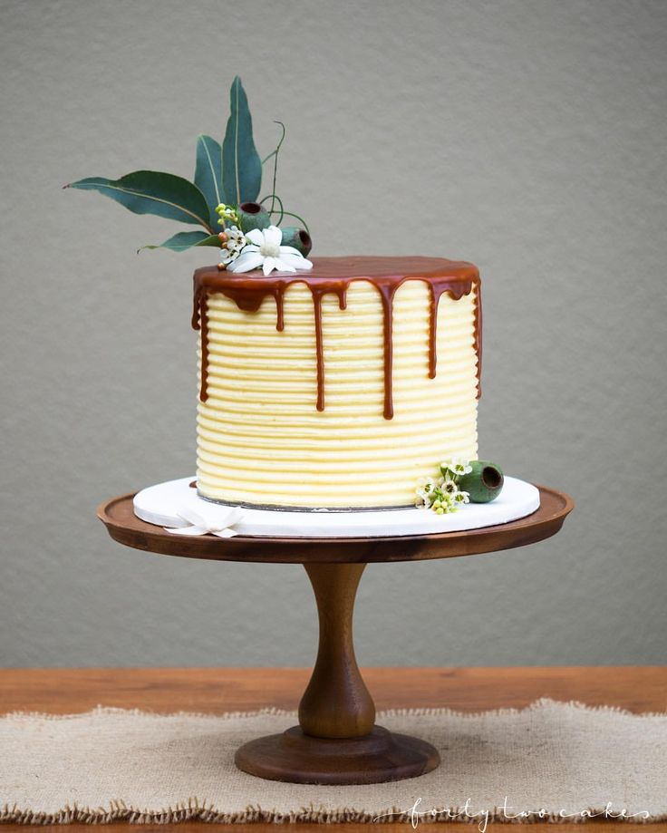"""Forty-Two Cakes on Instagram: """"Wedding cake trio 2/3 Caramel mudcake filled with white chocolate & vanilla bean Swiss meringue buttercream and salted caramel sauce; decorated in a textured buttercream finish with salted caramel drip; gorgeous Australian native flowers and greenery supplied by @moxomandwhitney (love those giant gumnuts!) ❤️ Venue: @goolabri in Sutton Cake stand: @anthropologie"""""""