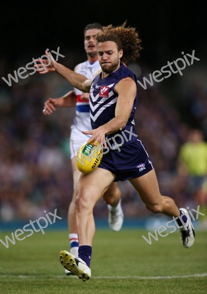 AFL Round 3 - Fremantle Dockers vs Western Bulldogs, at Subiaco Oval, Perth. Pictured - Fremantle's Griffin Logue pumps the ball into the forward line Picture: Daniel Wilkins