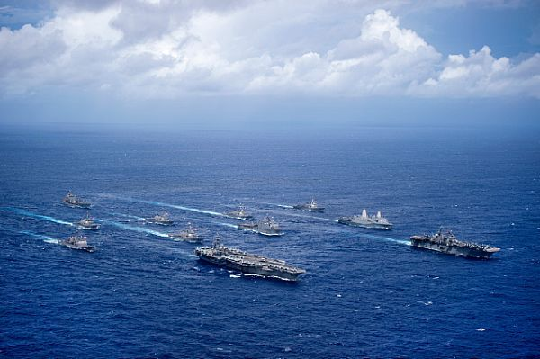 USS Ronald Reagan (CVN 76) and USS Bonhomme Richard (LHD 6) lead a formation of Carrier Strike Group Five and Expeditionary Strike Group Seven ships.