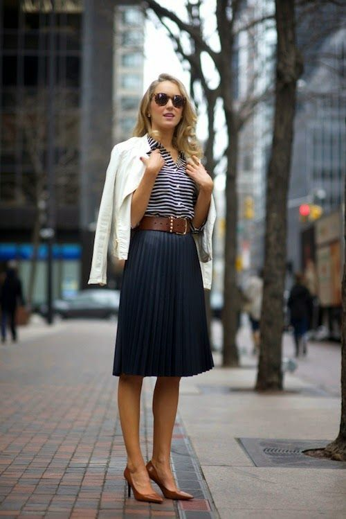 Go for a white leather biker jacket and a navy pleated silk midi skirt for both chic and easy-to-wear look. Take a classic approach with the footwear and make brown leather pumps your footwear choice.  Shop this look for $163:  http://lookastic.com/women/looks/pumps-waist-belt-biker-jacket-sunglasses-midi-skirt-dress-shirt/4360  — Brown Leather Pumps  — Dark Brown Leather Waist Belt  — White Leather Biker Jacket  — Brown Sunglasses  — Navy Pleated Silk Midi Skirt  — White and Navy Horizontal…