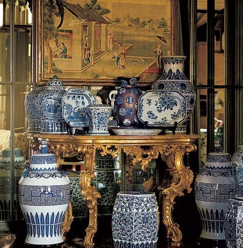 A collection of blue-and-white Chinese porcelain is displayed in Valentino's Rome apartment decorated by Renzo Mongiardino.: