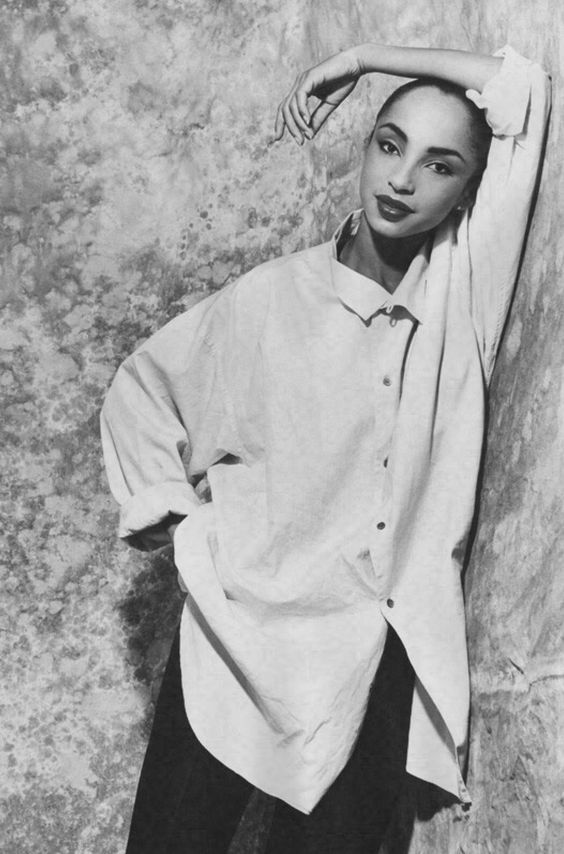 Sade in an oversized white shirt. Best part – exposed buttons and no pocket