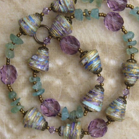Paper jewelry- Paper Bead Necklace-Soft shades In soft shades of blue,mauve,green and gold this handmade paper jewelry is very feminine and pretty to wear. $90.00