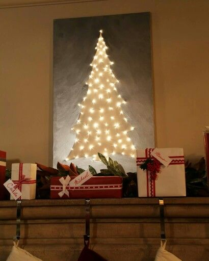 Clinton Kelly light up canvas tree. Paint canvas and poke lights through from the back.