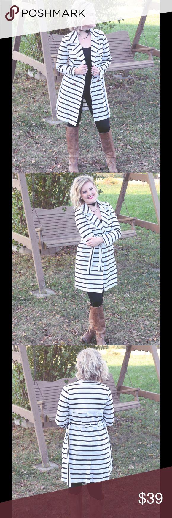 White/Black Stripe Jacket Model is wearing size medium. White/black stripe jacket with belt Boutique Jackets & Coats