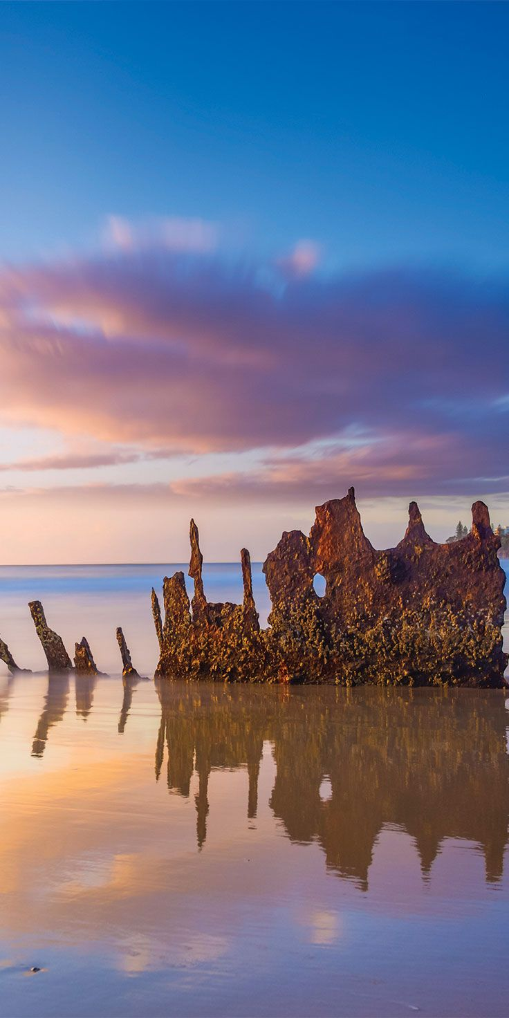 The iconic wreck of SS Dicky on the shores of Dicky Beach, Caloundra - by Larissa Dening & @visitqueensland