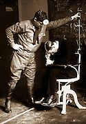 Subjecting the prospective American airman to the falling test.  The sixth sense - that of equilibrium - is the function of the labyrinth of the internal ear.  March 19, 1918.  Photograph by Underwood & Underwood