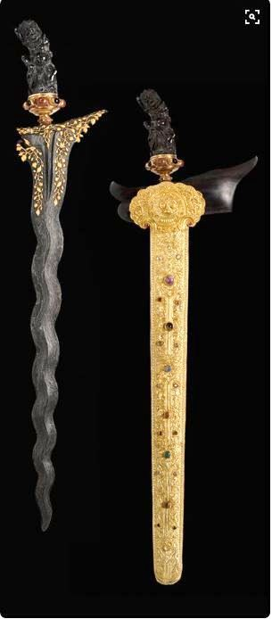 This is a Keris. It is Indonesian knife and it used to be worn by the sultan. It is that a ghost lives in the knife so the knife always comes back to the owner. It symbolises authority and dignity.