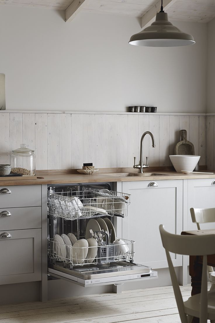 An integrated dishwasher is practical, handy and easily concealed. Shown here in our Allendale Dove Grey Shaker Style kitchen. Contact your local Howdens depot for more information.