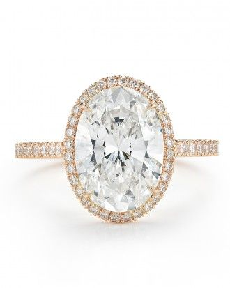 Kwiat 3-carat oval-cut diamond with pavé diamond frame set in 18-karat rose gold