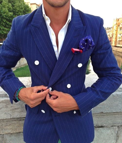 Double Breasted Blazer with white buttons going well with the pocket square