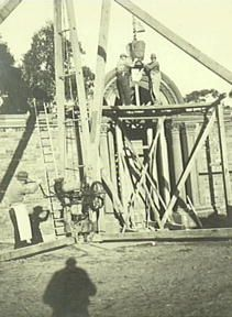 Everglades 1933 - 1943, lowering the masonry into place for the garden theatre. The arch was rescued from a Sydney bank building that was being demolished