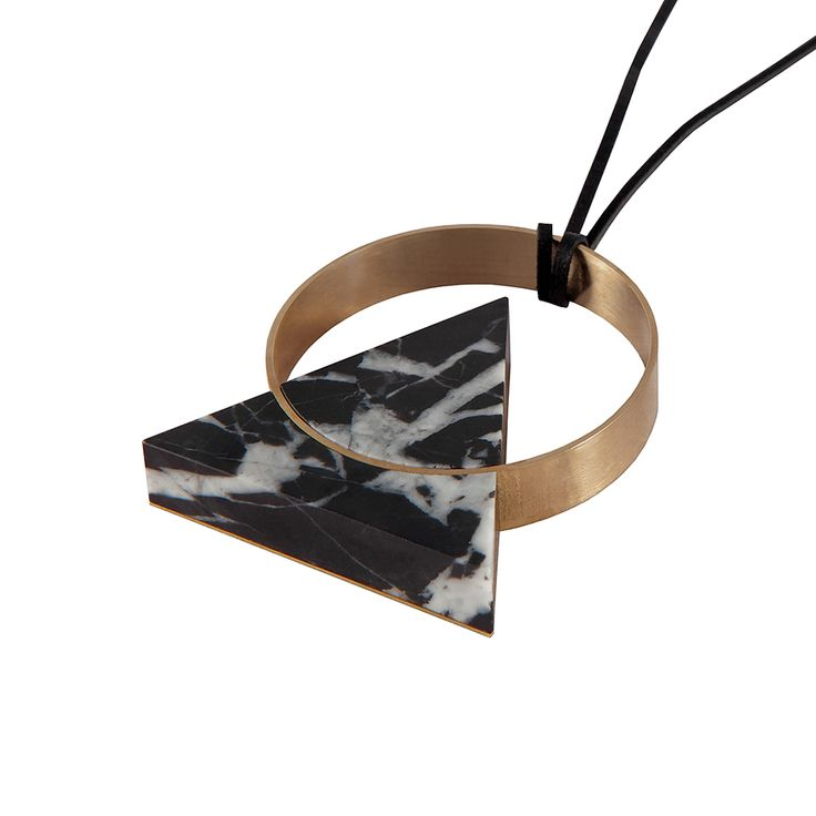"""An original handmade piece of jewelry""  Two-sided necklace made of marble and brass. Unique structures and grains of stone captured in simple geometric shape make every piece a timeless original.  Comes with a 45 cm leather cord settled in a soft pillow in a black box."