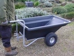 Garden trailer being pushed. For more info: http://www.fresh-group.com/trailers-trolleys-and-carts.html