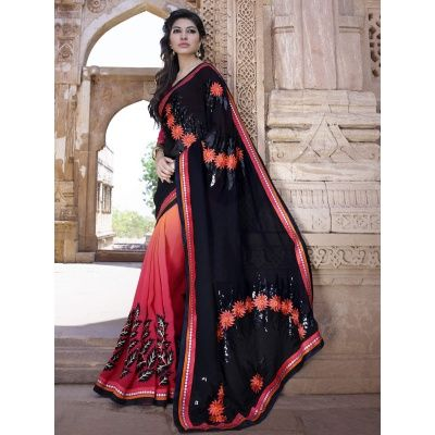 Unique Black Color Georgette Designer Saree comes with Red Color Dhupian Blouse. It contained the Embroidery, Sequence & Multi work with Lace border. The Blouse can be customized up to bust size 44