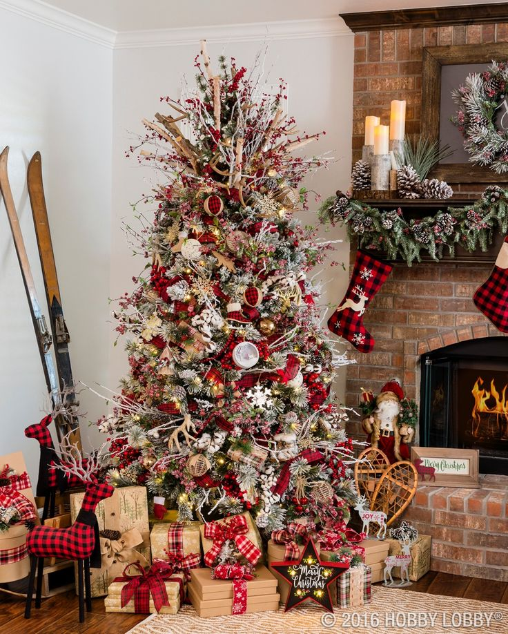 cozy cabin charm meets traditional holiday by coupling warm and rustic accent pieces with elegant christmas