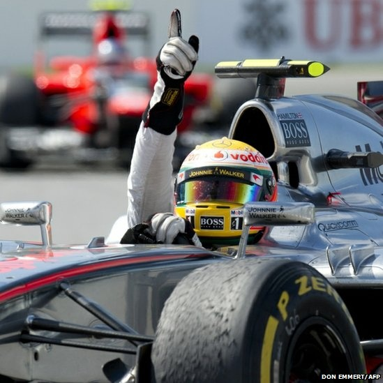 McLaren Mercedes driver Lewis Hamilton celebrates winning the Canadian Grand Prix.