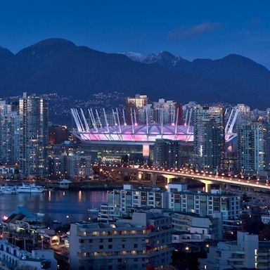 A lit up view of BC Place from our Executive View King room