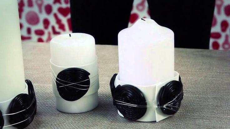 Decorazioni black & White con le caramelle gommose di liquerizia e delle candele