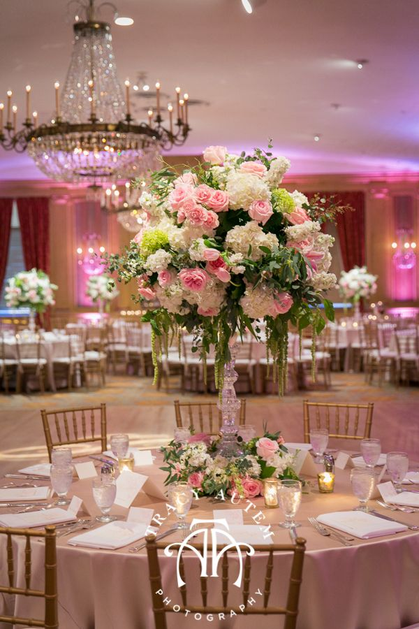 Tami Winn Events creates a beautiful reception using white hydrangeas with pops of pink roses and green in glass vases as the table center pieces. Wedding Reception at Fort Worth Club