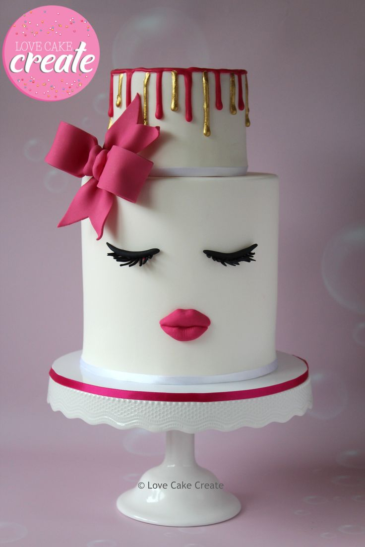 Lips and lashes cake with a pink bow and gold drip - by Love Cake Create