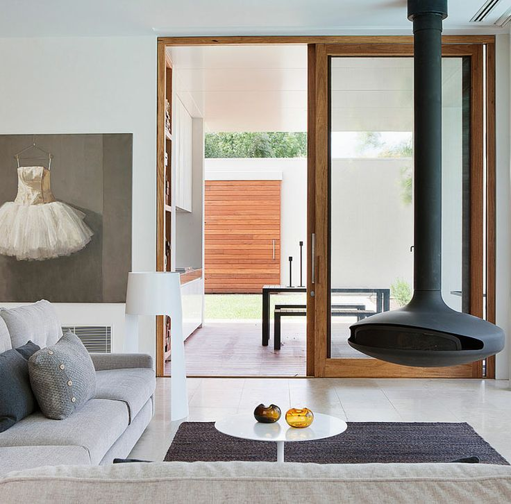 Mid century suspended fireplace + contemporary decor + art