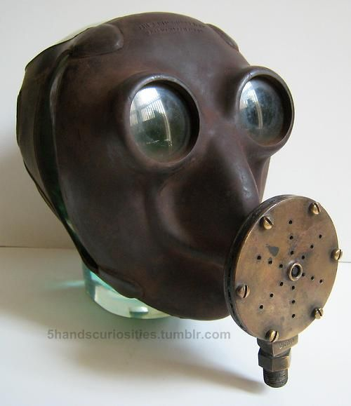 A very scarce and sculptural Bug/Insect Eye diving mask with yellow glass lenses and brass mouthpiece. 1941. Adopted as a prototype for navy quite briefly. Reminds me very much of Kroenen. There is one for sale here https://www.etsy.com/listing/110607964/spectacular-scarce-vintage-insect-bug
