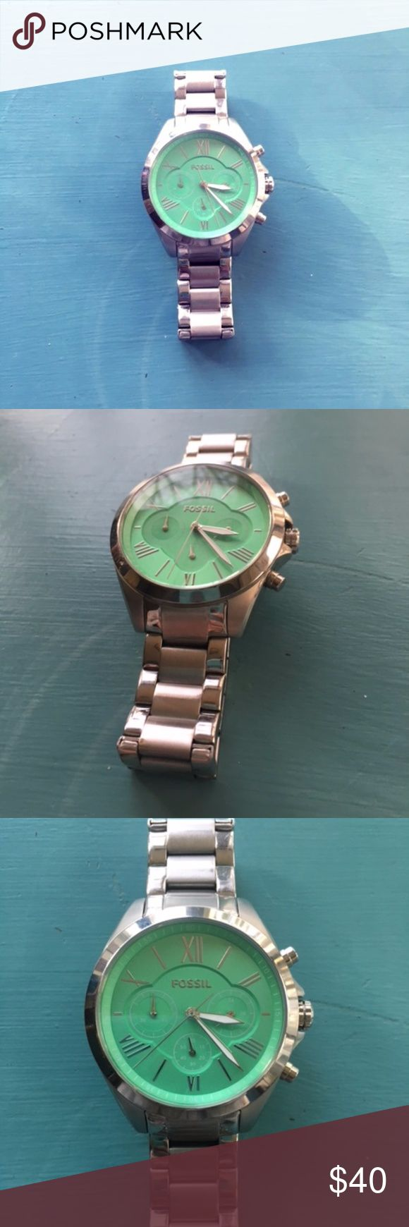 Silver Fossil Watch with Teal Face Used silver Fossil oversized watch with teal face. Numbers are marked in Roman numerals. Gently used, some scuffing on back of band. Feel free to message for more pics or if you have questions. Fossil Accessories Watches