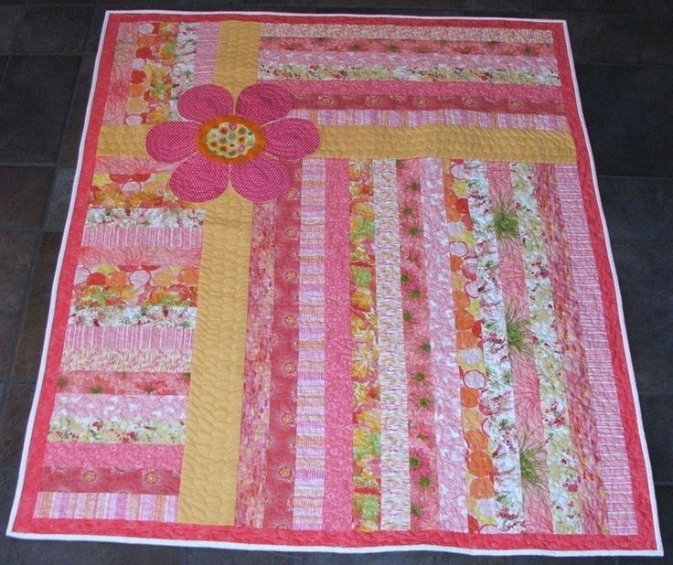 Love the colors! Quick and easy quilt for a little girl!Maybe a car instead of a flower for a boy??