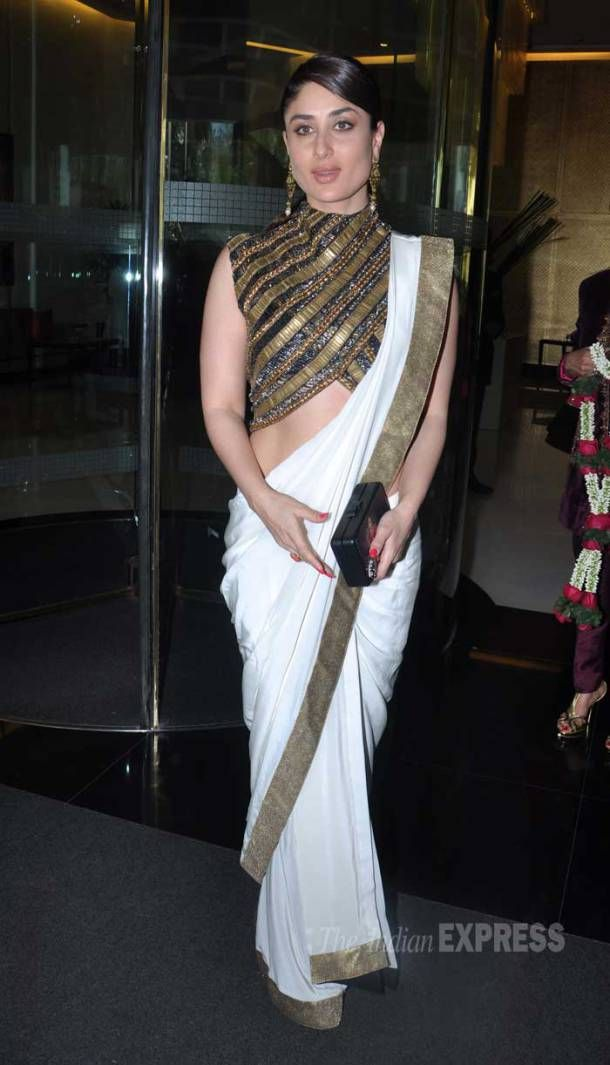 Kareena Kapoor Khan donned an interesting look as she attended a lunch hosted by socialite Chhaya Momaya in honour of First lady of France, Valerie Trierweiler. The actress picked a Anand Kabra creation pairing it with a Pinky Saraf clutch and earrings from Gehna. (Photo: Varinder Chawla) @indianexpress via @sunjayjk #saree #sarees #choli #sareeblouse #bollywood #bollywoodfashion #indianfashion #kareenakapoor